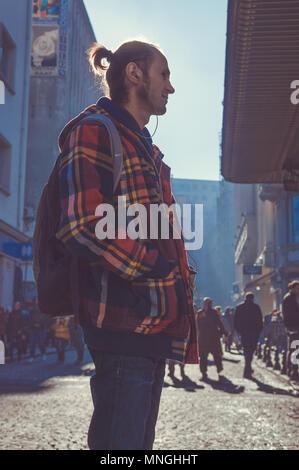 Istanbul, Turkey - January 06, 2018: Young male tourist walking in touristic Eminonu district of Istanbul city, Turkey - Stock Photo