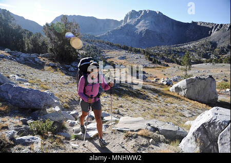Backpacker hiking on Mammoth Crest to Mammoth Lakes on trek of Sierra High Route in John Muir Wilderness in California, USA - Stock Photo