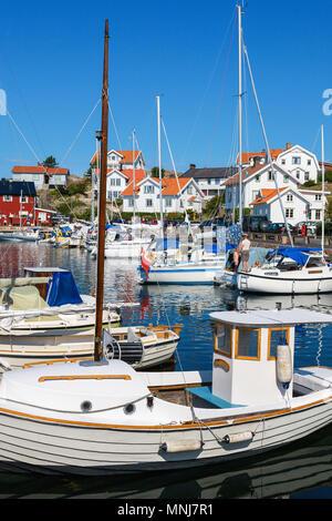 Fishing boat in the harbor of Mollosund on the Swedish west coast - Stock Photo