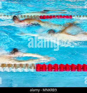 Sport in swimmingpool - Stock Photo