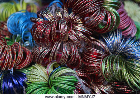 Colorful glass bangles for sale in a small market in Sikkim. - Stock Photo