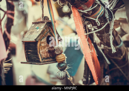 closeup photo of a tiny decorative house in the garden - Stock Photo