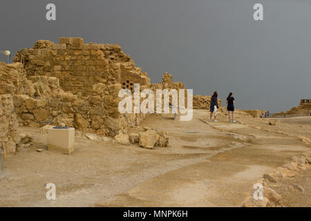 Some of the reconstructed ruins of the ancient Jewish clifftop fortress of Masada in Southern Israel.  This was the scene of an historic mass suicide. - Stock Photo