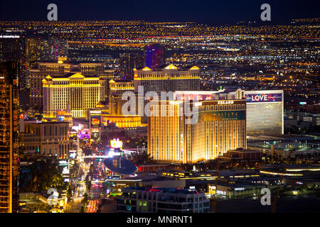 LAS VEGAS - MAY 15, 2018: Beautiful cityscape aerial view across Las Vegas Nevada at night with lights and many luxury resort hotels and casinos in vi - Stock Photo