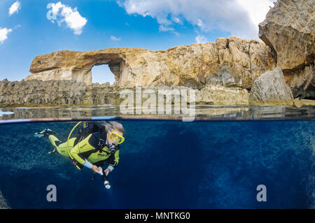 Azure Window, or Dwejra Window, and woman scuba diver in Blue Hole, Gozo, Malta, Mediterranean Sea, Atlantic Ocean, MR - Stock Photo