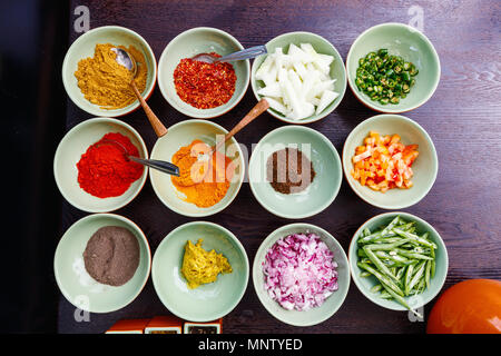 Spices cooking ingredients for making curry - Stock Photo
