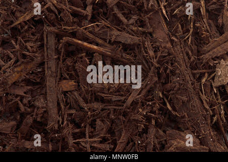 Tree bark and wood chips mulch used in horticulture closeup texture background - Stock Photo