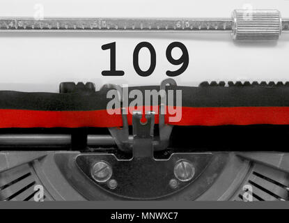 109 Number text written by an old typewriter on white sheet - Stock Photo