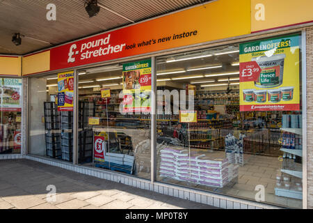 Exterior of a Poundstretcher discount shop in Hamilton, South Lanarkshire, Scotland, UK. Posters, display units and goods for sale. - Stock Photo