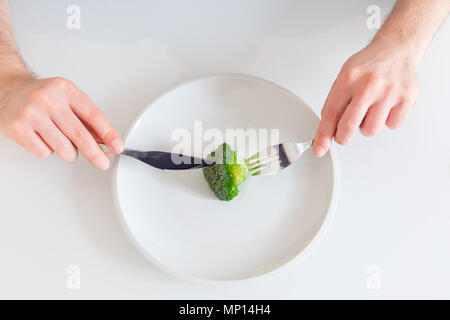 Empty dish with single cabbage vegetable meaning diet concept - Stock Photo