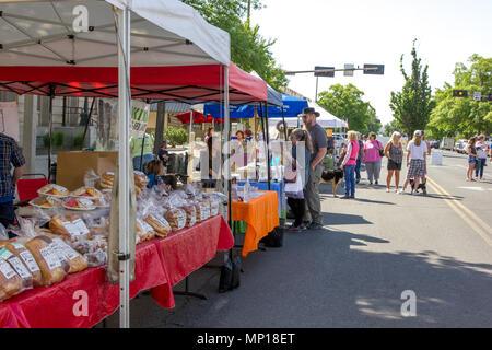 Yakima, Washington / USA - May 21, 2018: People from around the community of Yakima gather on a beautiful day at the downtown farmer's market. - Stock Photo