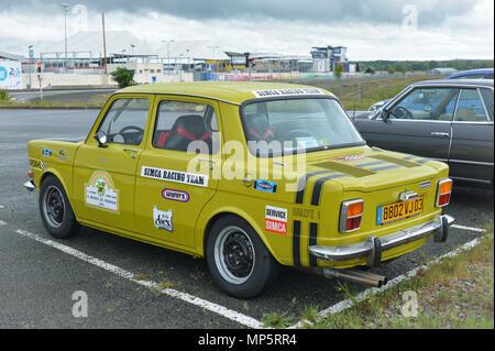 LE MANS, FRANCE - APRIL 30, 2017: Vintage french race touring yellow car Simca logo - Stock Photo