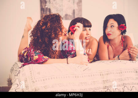 group of three caucasian beautiful friends woman females at home celebrate and in nice leisure activity. friendship with smiles and enjoying the time  - Stock Photo