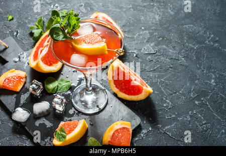 Margarita cocktail with grapefruit juice, cold summer citrus refreshing drink or beverage with ice - Stock Photo