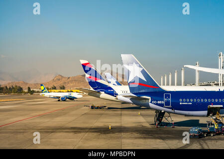 View from plane window, Santiago International airport of LATAM aeroplanes. New and old airline logos joining LAN and TAM airlines & SKY airline - Stock Photo
