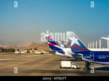 View from plane window, Santiago International airport of LATAM aeroplanes. New and old airline logos joining LAN and TAM airlines & SMART airline - Stock Photo
