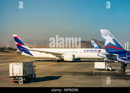 View from plane window, Santiago International airport of LATAM aeroplanes on apron, with new and old airline logos, joining LAN and TAM airlines - Stock Photo