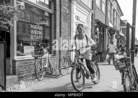 31st August 2017, Potsdam, GERMANY. View, Women Cycling on the Side Walk, on the LindenStrasse, Black and White, © Peter SPURRIER, - Stock Photo