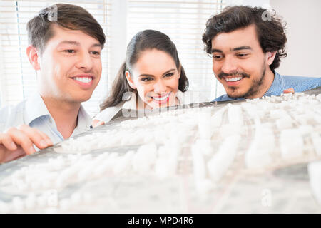 Architects with model for urban development - Stock Photo
