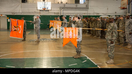 U.S. Army Soldiers of the 101st Expeditionary Signal Battalion, New York Army National Guard, stand at attention as Maj. Ian Seagriff assumes command of the battalion from outgoing commander Lt. Col. Diane Armbruster at the Police Athletic League Center, Yonkers, N.Y., April 9, 2017. - Stock Photo