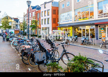 One of the many typical Dutch shopping streets in the famous city centre of the historic city of Zwolle, in the Netherlands. - Stock Photo