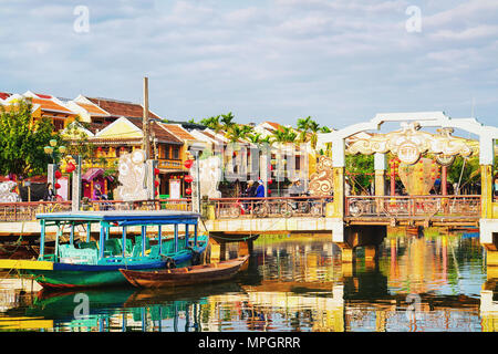 Hoi An, Vietnam - February 17, 2016: Boat at the Embankment of Thu Bon River, Hoi An, Vietnam - Stock Photo