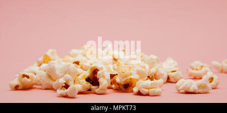 Popcorn on Pink Background. Top view - Stock Photo