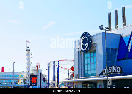 Opposing casinos with Big One roller coaster in background,Blackpool,Lancashire,UK - Stock Photo