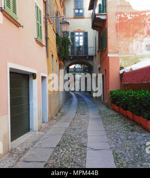 the narrow pedestrian streets typical of Orta, one of the most beautiful villages in Italy - Stock Photo