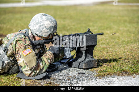 U.S. Army Pfc. Julius Forde zeroes his weapon before shooting a weapon qualification during the New York Army National Guard Best Warrior Competition at Camp Smith Training Site March 30, 2017. The Best Warrior competitors represent each of New York's brigades after winning competitions at the company, battalion, and brigade levels.  (U.S. Army National Guard photo by Sgt. Harley Jelis) - Stock Photo