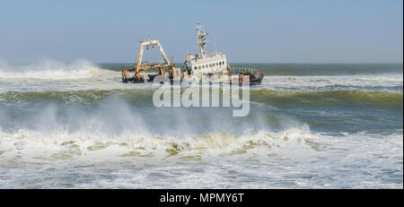 Shipwreck Zeila laying on sandbank during storm and waves - Stock Photo
