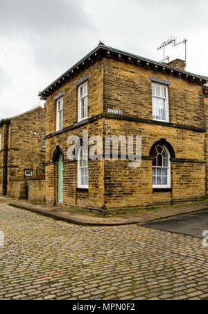 Cobbled streets of Saltaire village in West Yorkshire. Saltaire is a UNESCO designated World Heritage Site. - Stock Photo