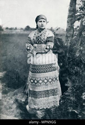 A Russian peasant in costume, 1912. Artist: Unknown. - Stock Photo