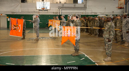 U.S. Army Soldiers of the 101st Expeditionary Signal Battalion, New York Army National Guard, stand at attention as Maj. Ian Seagriff assumes command of the battalion from outgoing commander Lt. Col. Diane Armbruster at the Police Athletic League Center, Yonkers, N.Y., April 9, 2017. (U.S. Army National Guard photo by Sgt. Harley Jelis) - Stock Photo