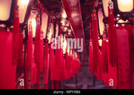 Illuminated red Chinese Lanterns hanging on ceiling - Stock Photo