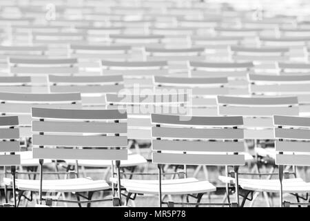 White chair rows in a spa park in Black & White bright light - Stock Photo