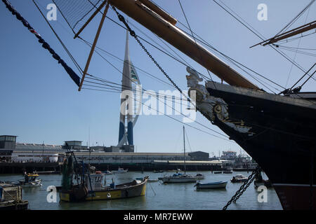 HMS Warrier in Portsmouth Historic Dockyards, UK, with the Emirates Spinnaker in the background - Stock Photo