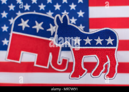 US Democrat Donkey logo & Republican elephant logo on Stars and Stripes. For 2020 US General election, Midterms, and 2020 Presidential election USA - Stock Photo