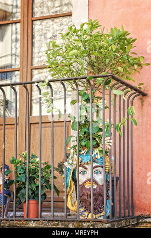 Flowered balcony with sicilian decorated vases - Stock Photo