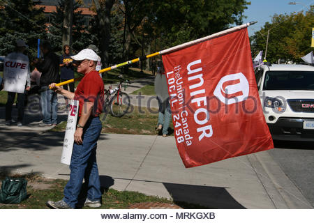 Windsor, Ontario, Canada. September 26, 2013 --- Members of the UNIFOR (Union for Canada) join the picket line in front of the University of Windsor t - Stock Photo