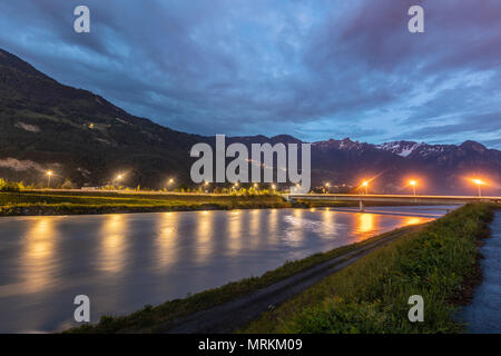 Dramatic sky in the mountains. Bridge across the Rhine. - Stock Photo
