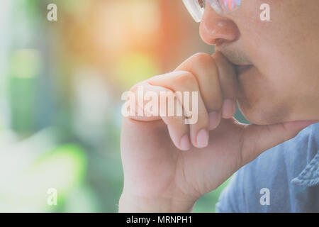 Male designers are working outside the office with natural light under the tree. - Stock Photo