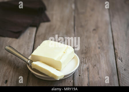 Butter on dark wooden background, copy space. Farm dairy product - butter. - Stock Photo