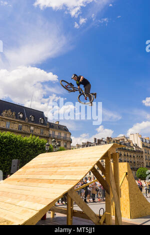 PARIS ,FRANCE- 27 May 2018: young man on bmx doing tricks, during a Freestyle bmx demonstration, in the center of Paris. - Stock Photo