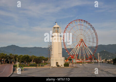 Ferris wheel in the Park of Miracles on the embankment. Batumi, Georgia - Stock Photo