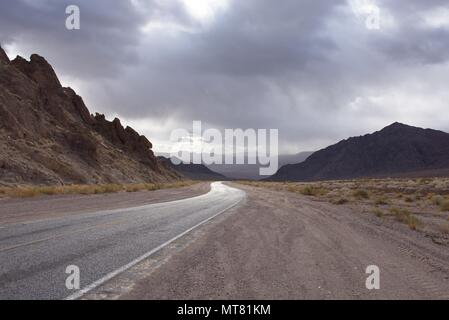 Death valley entrance in cloudy rainy weather - Stock Photo