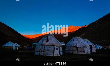 Sunrise over kyrgyz Yurts at Tash-Rabat river and valley at Naryn province, Kyrgyzstan - Stock Photo