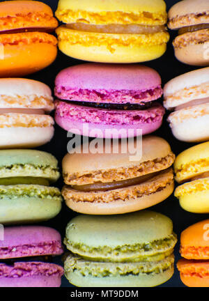 Colorful macaroons on stone table. - Stock Photo