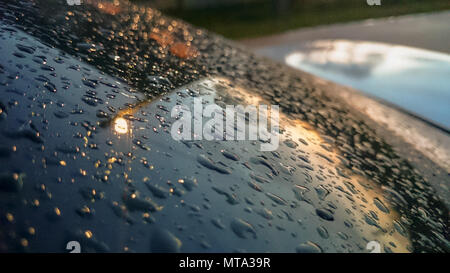 Many of raindrops stuck on the windshield background,Abstract of raindrops on the mirror made with color filters. - Stock Photo