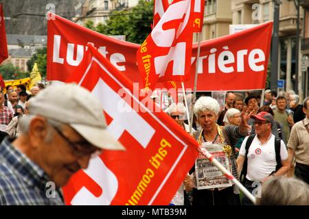 Labor and political demonstration of the popular tide initiated by Jean Luc Melenchon and the Insoumis against president Macron. - Stock Photo